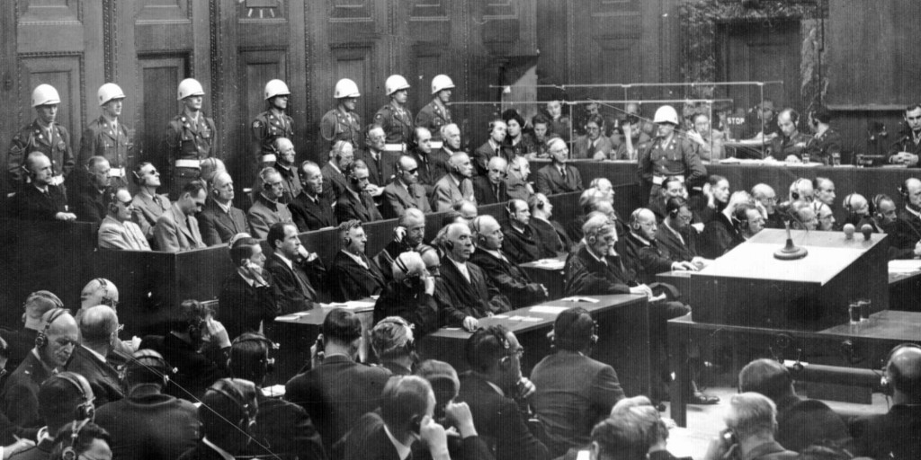 This is a general view of the War Crimes trial in Nuremberg, Germany in October of 1946, during the verdict phase of the trial. Prosecution is in the foreground and defense counsel is in front of the defendents. (AP Photo)